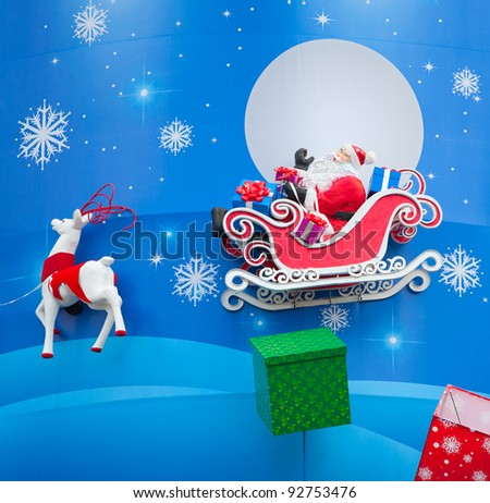 HO CHI MINH CITY, VIETNAM - DECEMBER 2: Christmas decoration in a department store showing Santa Claus on a sledge with deer and moon on December 2, 2011 in Ho Chi Minh City.