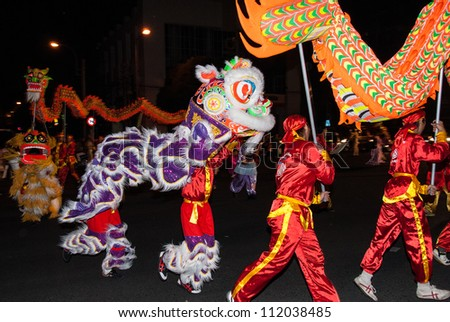 HO CHI MINH CITY, VIETNAM - FEBRUARY 13: A group of unidentified boys dance with their colorful dragons during the Tet Lunar New Year celebrations on February 13, 2007 in Ho Chi Minh City, Vietnam. - stock photo