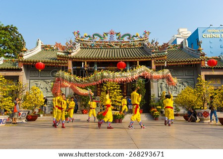 Ho Chi Minh City, Vietnam - February 18, 2015: A show of lion and dragon dance at Pagoda, China Town, District 5, Cho Lon to praying heathty, safety and lucky during the lunar new year. - stock photo
