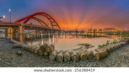 Ho Chi Minh City, VietNam FEBRUARY, 05, 2015: panorama view of new and old BINH LOI bridge in sunset . Ho Chi Minh city is the biggest city in Vietnam. - stock photo