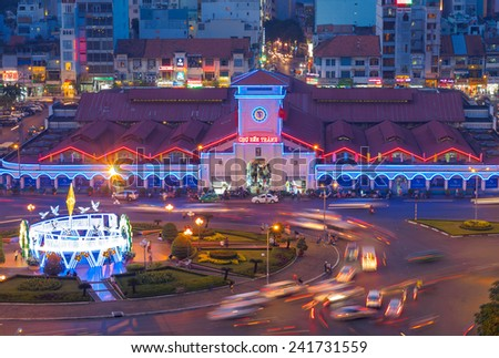 HO CHI MINH CITY, VIETNAM - JANUARY 3, 2015 : Aerial view of Ben Thanh market with traffic near by at night 2015, the iconic and antique building in Saigon from 1859.  - stock photo
