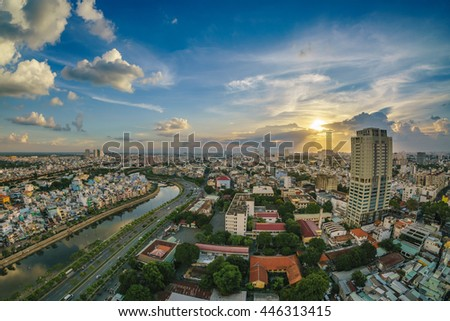 HO CHI MINH CITY , VIETNAM , JULY 01 2016 : Colourful night city with clouds on Tau Hu canal and the East-West Highway (Vo Van Kiet street) in Ho Chi Minh City (Saigon).View from a roof of building. - stock photo