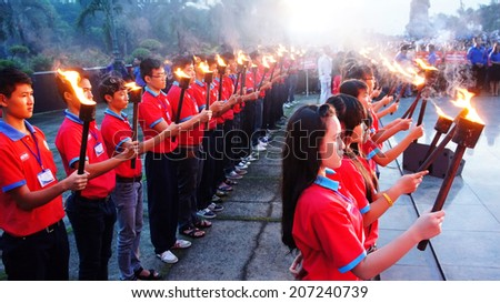 HO CHI MINH CITY , VIETNAM- JULY 26: Crowd of people standing, hold torch in July 27 event, ceremony to commenorate heroic that sacrifice in Vietnam war at martyr cemetery, Viet Nam, July 26, 2014