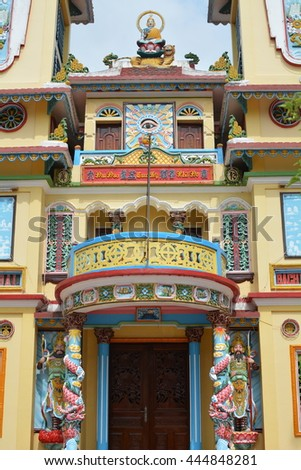 HO CHI MINH CITY, VIETNAM, JUNE 15, 2016, Entrance to Buddhist Temple, Yellow Building, Carved Wooden Painted Sculptures, Eye, Balcony, Pillars, Asia Pacific, Documentary Editorial