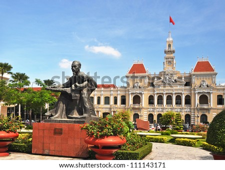 HO CHI MINH CITY, VIETNAM - JUNE 08: Statue of Vietnam's revered leader Ho Chi Minh (also called Uncle Ho or Bac Ho) in front of The Peoples' Committee building on June 08, 2011 in Ho Chi Minh Square. - stock photo