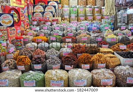 HO CHI MINH CITY, VIETNAM - JUNE 04, 2011: Sweet Stall at Ben Tanh Market including biscuits, boiled sweets and dried fruits. - stock photo