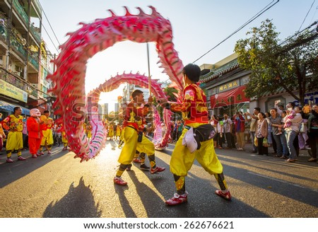 Ho Chi Minh City, Vietnam - Mar 04, 2015: A show of dragon dance at Pagoda, China Town, District 5, Cho Lon to praying heathty, safety and lucky during the lunar new year. - stock photo