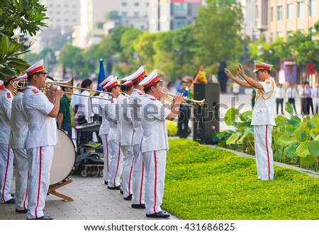 HO CHI MINH CITY, VIETNAM - MAY 19, 2016: A military band plays at the ceremony of bringing flowers to the Ho Chi Minhs monument on his birthday, an official public holiday.  - stock photo