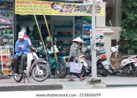 Ho Chi Minh City, Vietnam-29th Oct 2013: A typical street scene. In many areas of the city motorbikes litter the pavements. - stock photo