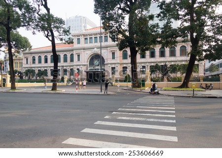 Ho Chi Minh City, Vietnam-29th Oct 2013: Early morning ouside the Central Post Office. The building was designed by the architect Gustav Eiffel in the early 20th century. - stock photo