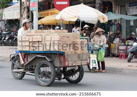 Ho Chi Minh City, Vietnam-30th Oct 2013: Man on motor tricycle transporting boxes. Motorcycles are used to transport many different items across the city. - stock photo