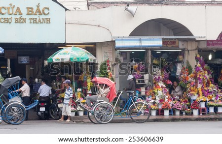 Ho Chi Minh City, Vietnam-29th Oct 2013: Street scene outside Ben Thanh Market. The market is the main market in the city selling food, clothing and tourist souvenirs. - stock photo
