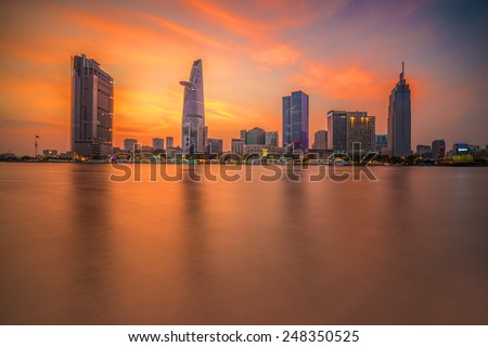 HO CHI MINH- VIET NAM 28-01-2015Cityscape of Ho Chi Minh city at beautiful sunset, viewed over Saigon river. Hochiminh is the largest city in Vietnam with population around 10 million people - stock photo