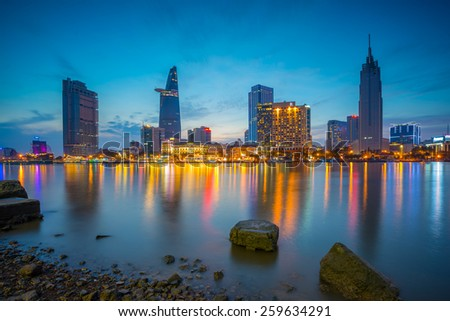Ho Chi Minh- Viet Nam Feb 11 2015. Cityscape of Ho Chi Minh city at beautiful sunset, viewed over Saigon river. Hochiminh is the largest city in Vietnam with population around 10 million people - stock photo