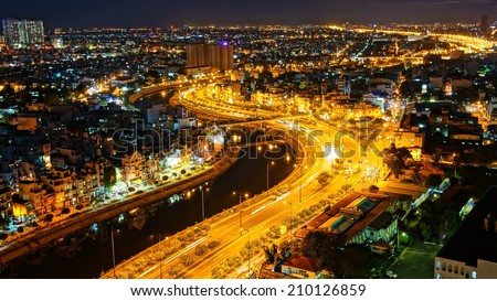 HO CHI MINH ,VIETNAM- AUG 7: Impression landscape of Asia city at night, group of house along Tau hu canal, yellow trail on street, panaromic from high view make colorful scene, Viet Nam,Aug 7,2014