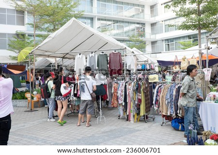 HO CHI MINH, VIETNAM - DEC 07 2014: Unidentifed people shopping at Flea market Phu My Hung, Distric 7 in Ho Chi Minh, Vietnam. - stock photo