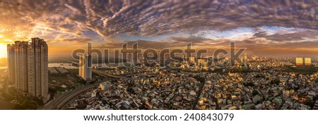 HO CHI MINH, VIETNAM - DECEMBER, 25, 2014 : Aerial panoramic sunset view of HO CHI MINH downtown. HO CHI MINH city is the biggest city in VIETNAM - stock photo