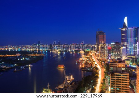 HO CHI MINH, VIETNAM - FEB 18, 2012 : Aerial view of Ho Chi Minh city riverside at night. - stock photo