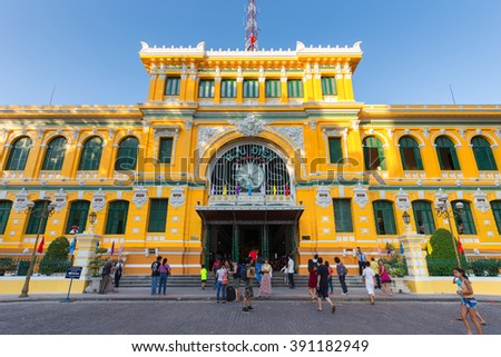 HO CHI MINH, VIETNAM, FEBRUARY 25, 2015 : Front view on the central French colonial style post office with tourists in Ho Chi Minh city (Saigon), Vietnam
