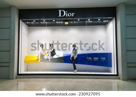 HO CHI MINH, VIETNAM - JAN 21, 2014: Christian Dior boutique display window with haute couture clothes and luxury accessories for exclusive shopping and in most attractive tourists city in Vietnam - stock photo