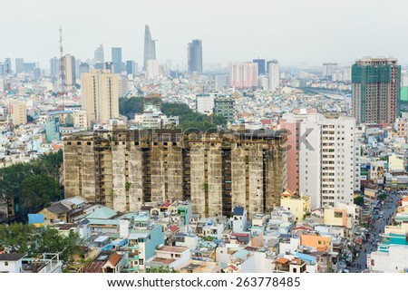 HO CHI MINH, VIETNAM - JAN 9, 2015. Saigon skyline in the sunset, Ho Chi Minh city (or Saigon) is the biggest city in Vietnam. - stock photo