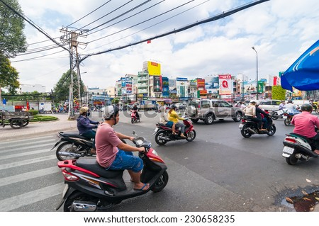 HO CHI MINH, VIETNAM - JAN 21, 2014: Street view of road traffic at Ho Chi Minh City (Saigon) the biggest city in Vietnam popular business center and modern tourist attraction - stock photo