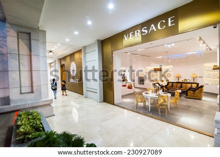 HO CHI MINH, VIETNAM - JAN 21, 2014: Versace boutique display window with luxury furniture and fashion accessories for exclusive shopping and relaxing in most attractive tourists city in Vietnam - stock photo