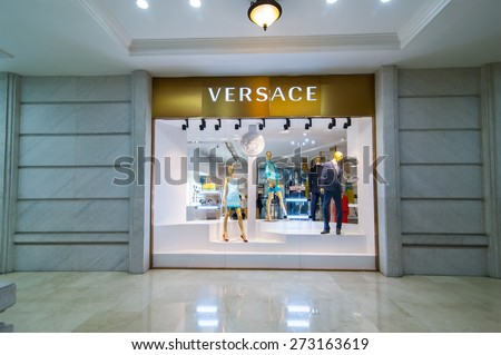 HO CHI MINH, VIETNAM - JAN 21, 2014: Versace boutique display window with mannequin in haute couture clothes and luxury accessories for exclusive shopping in most attractive tourists city in Vietnam - stock photo