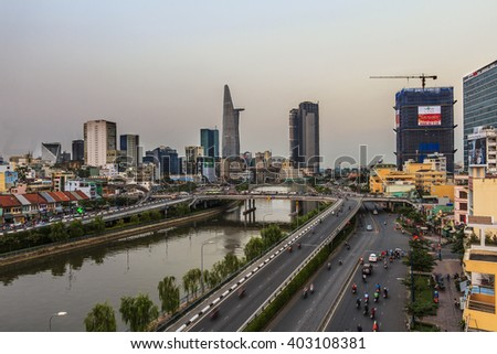 HO CHI MINH, VIETNAM - JANUARY, 26, 2015 : Aerial night view of HO CHI MINH downtown with bridge and BEN NGHE canal .. HO CHI MINH city is the biggest city in VIETNAM