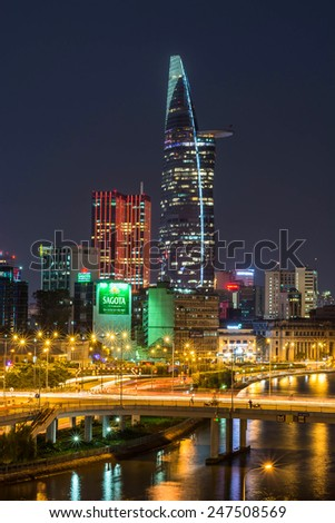 HO CHI MINH, VIETNAM - JANUARY 26, 2015 :Landscape orientation of buildings and building Betexco Time Square from a hotel Tau Hu canal, in Ho Chi Minh City (Saigon), Vietnam. - stock photo