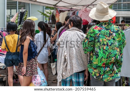 HO CHI MINH, VIETNAM - JULY 27: Unidentified people shopping at Flea market in Phu My Hung, District 7 on July 27, 2014 in Ho Chi Minh, Vietnam. - stock photo