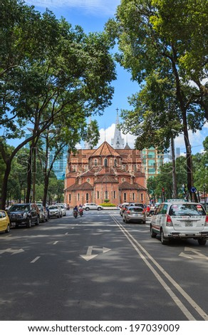 HO CHI MINH, VIETNAM - June 6, 2014: Traffic near Notre Dame cathedral ( Duc Ba Church ), is a cathedral located in the downtown of Ho Chi Minh City. - stock photo