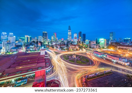 HO CHI MINH, VIETNAM - November 6, 2014: Downtown Saigon and Quach Thi Trang park at blue hour on November 6, 2014, in Ho Chi Minh city, Vietnam. Ho Chi Minh city is the biggest city in Vietnam - stock photo