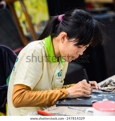 HO CHI MINH, VIETNAM - SEP 20, 2014: Unidentified Vietnamese girl works in a factory. 90% of Vietnamese people belong to the Viet ethnic group