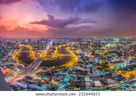 HO CHI MINH, VIETNAM - September 24, 2014: sunset on NHIEU LOC canal across the buildings and houses in Ho Chi Minh city.Ho Chi Minh city is the biggest city and economic center in Vietnam. - stock photo
