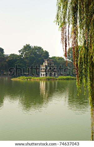 Ho Hoan Kiem, the little lake in the old part of Hanoi, Vietnam, with the Tortoise Tower. Tortoise Tower is the symbol of Hanoi,Vietnam
