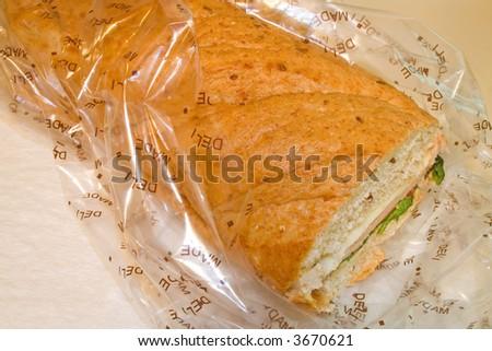 Hoagie sandwich in wrapper - stock photo
