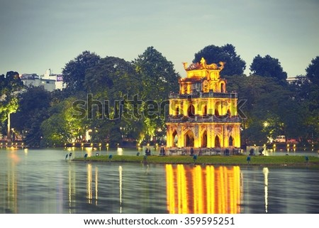 Hoan Kiem Lake (Lake of the Returned Sword) and Turtle Tower in Hanoi - Vietnam - stock photo
