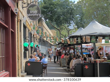 HOBART AUSTRALIA - MARCH 15, 2014: Unidentified people dine at Salamanca Market - Hobart is the state capital of Tasmania and Australia's second oldest capital city after Sydney.     - stock photo