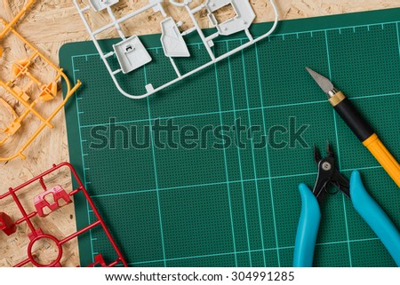 Hobby background, assembling the plastic model kits - stock photo