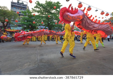 Hochiminh City, Vietnam - February 22, 2016: Parade of dragons and lions in the lion dance ceremony of Chinese Vietnamese people on a street in the HoChiMinh city on season Tet holiday of lunar year