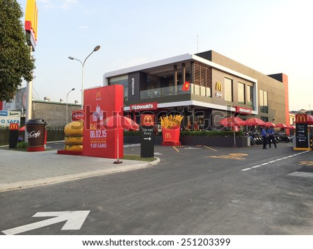 HOCHIMINH, VIETNAM - FEB 9, 2015: A new restaurant (opened on Feb. 6) of the McDonalds Corporation, the worlds largest chain of hamburger fast food restaurants, serving 68 million customers daily. - stock photo