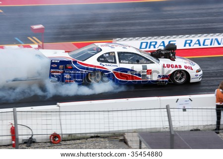 HOCKENHEIM - AUGUST 16 : Driver N. Kuno performs a burnout during qualifying at nitrolympics drag racing event August 16, 2009 in Hockenheim, Germany. - stock photo