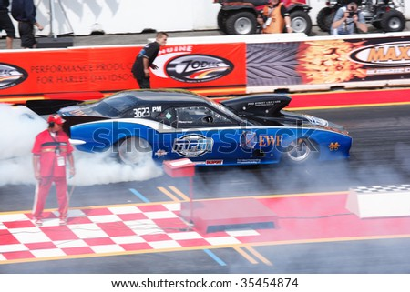 HOCKENHEIM - AUGUST 16 : Driver Robert Koper performs a burnout during qualifying at nitrolympics drag racing event August 16, 2009 in Hockenheim, Germany. - stock photo