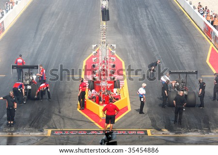 HOCKENHEIM - AUGUST 16 : Unidentified teams get ready for qualifying at nitrolympics drag racing event August 16, 2009 in Hockenheim,  Germany. - stock photo