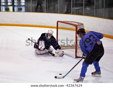 Hockey goaltender makes a save - stock photo