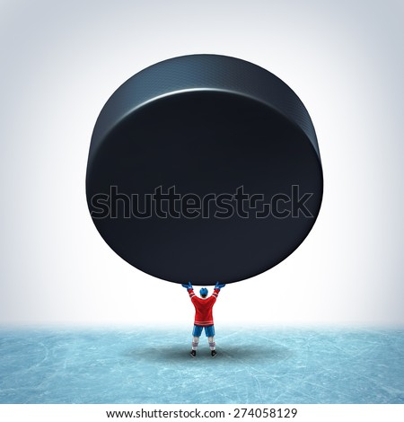 Hockey ice champion concept as a player in uniform holding up a giant puck with blank copy space on a rink as a victory or tournament championship icon for winning and scoring in a winter team sport. - stock photo