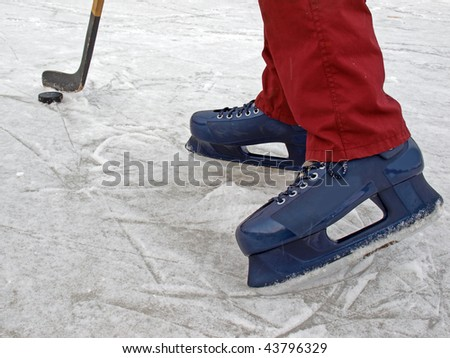 Hockey on the country pond, details close up - stock photo