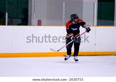 Hockey player looking at the play behind him