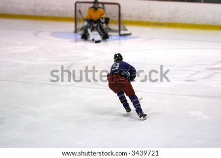 Hockey player skates towards the net with speed on a breakaway